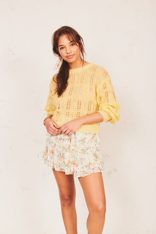 Yellow wool pullover sweater with dropped sleeves and floral print bows on back