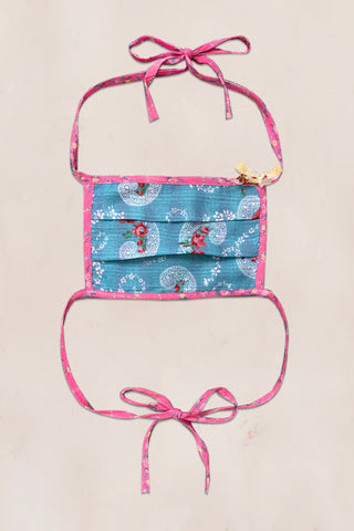 Reversible blue paisley and pink checkered print face mask with pink floral print head straps