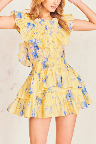 Yellow and blue floral print mini dress with elastic waist and tiered ruffle skirt and ruffle flounce top with button going down