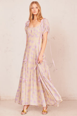 Yellow and purple floral maxi dress with front pocket detail and puffed short sleeves and bows at shoulders