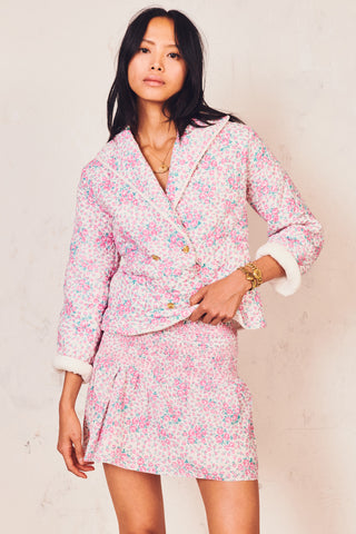 Pink and white floral print jacket with shawl collar and custom gold button detail