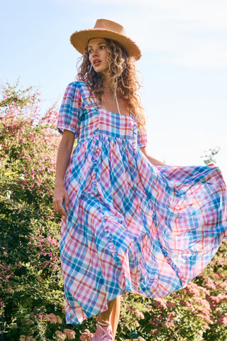 Blue and pink checker print flowy midi dress with fit and flare style and short sleeves