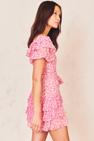 Pink floral print mini dress with front tie fitted waist and tiered ruffle skirt with puffed short sleeve and ruffle trim detail