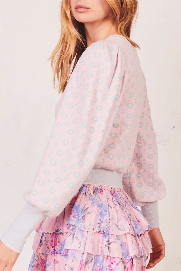 Pink and blue floral print long sleeve cardigan with buttons down and fitted bottom
