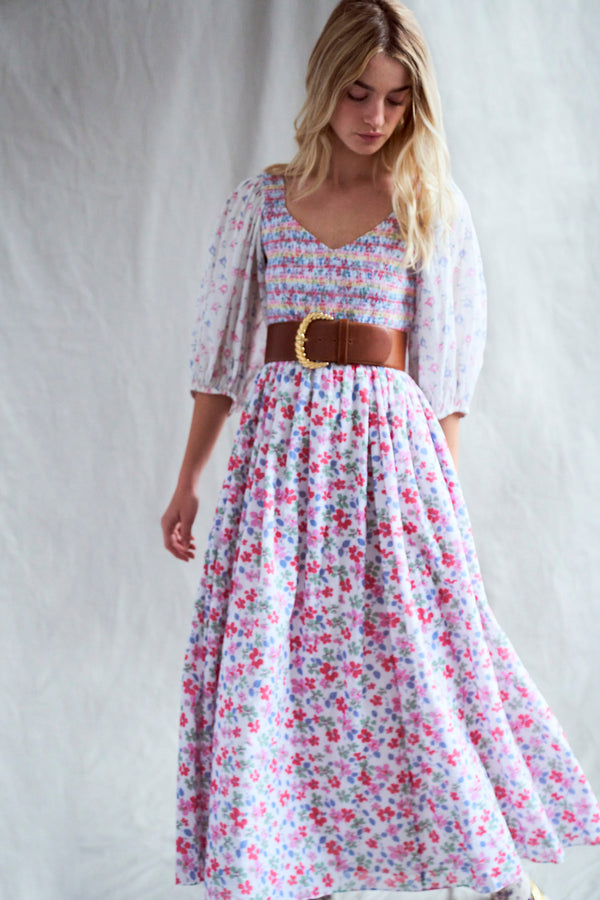 Multi-colored floral print maxi dress with long sleeves and smocked v neck top