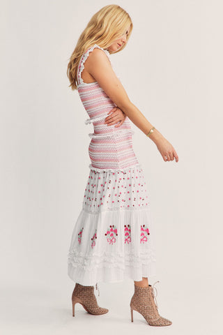 White floral embroidered high low skirt with smocked detailing on top and on back