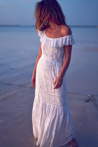 Fitted white maxi dress with white embroidery detail and scallop-edged ruffle flounce