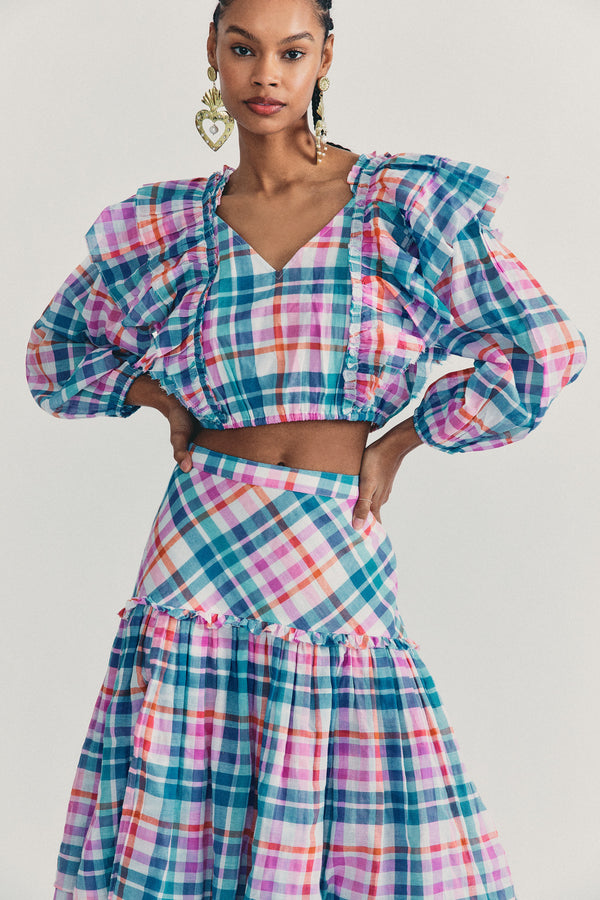 Blue and pink checkered print crop top with ruffle edge detail and long sleeves