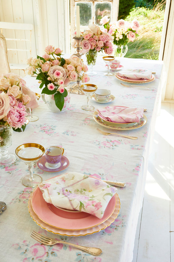 Pink floral print linen tablecloth with bows