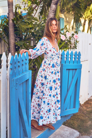 Blue, red and white floral print maxi dress with fitted waist and white embroidery detail and deep V-neck and puffed long sleeves
