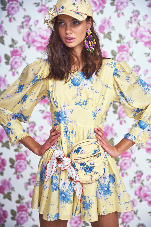 Yellow and blue floral print mini dress with fitted waist and puffed long sleeves