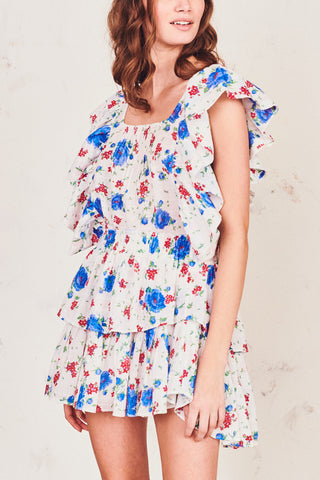 Blue, red, and white floral print mini skirt with elastic waist and tiered ruffle bottom