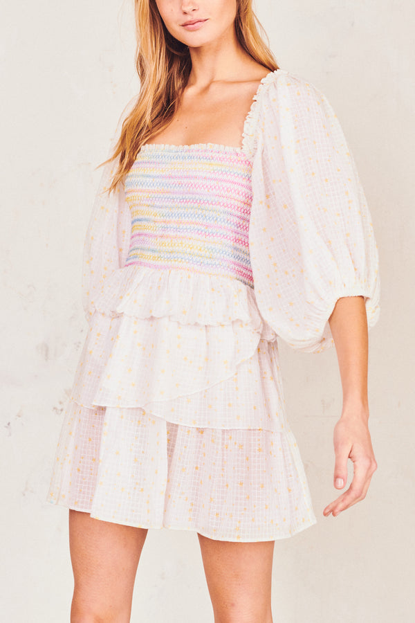 White and multi-colored shirred bodice mini dress with puffed long sleeves and tiered ruffle skirt
