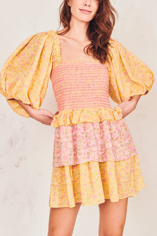 Pink and yellow floral print shirred bodice mini dress with puffed long sleeves and tiered ruffle skirt