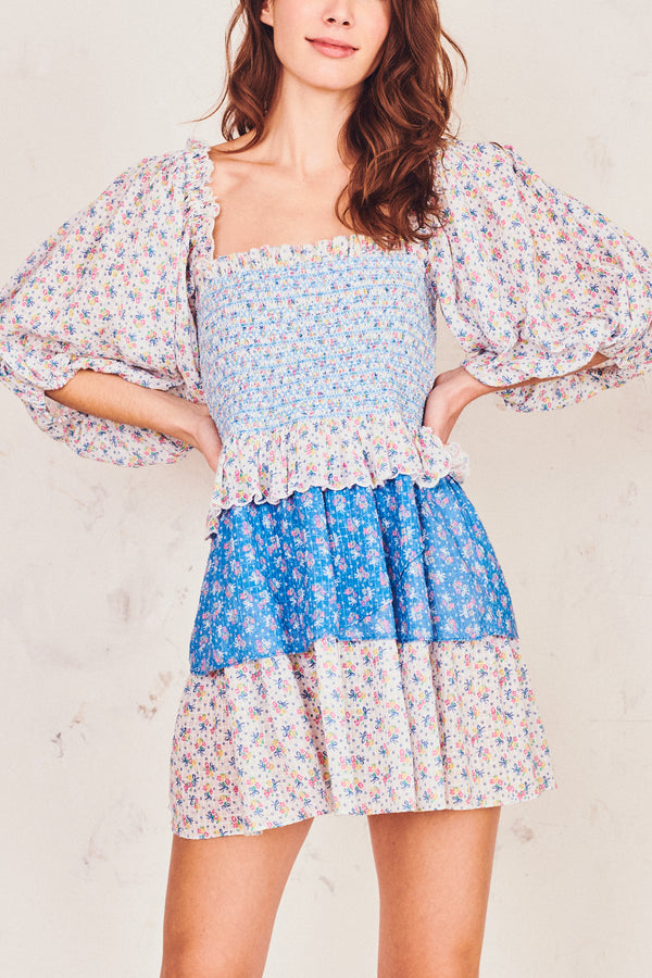 Blue and white floral print shirred bodice mini dress with puffed long sleeves and tiered ruffle skirt