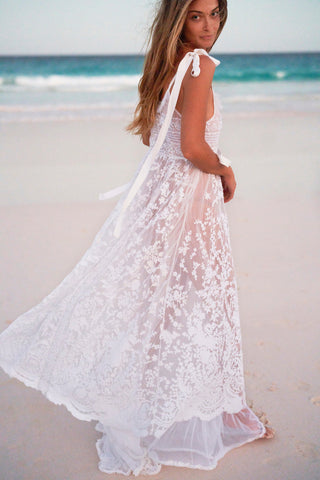 White lace maxi dress with bow at shoulders