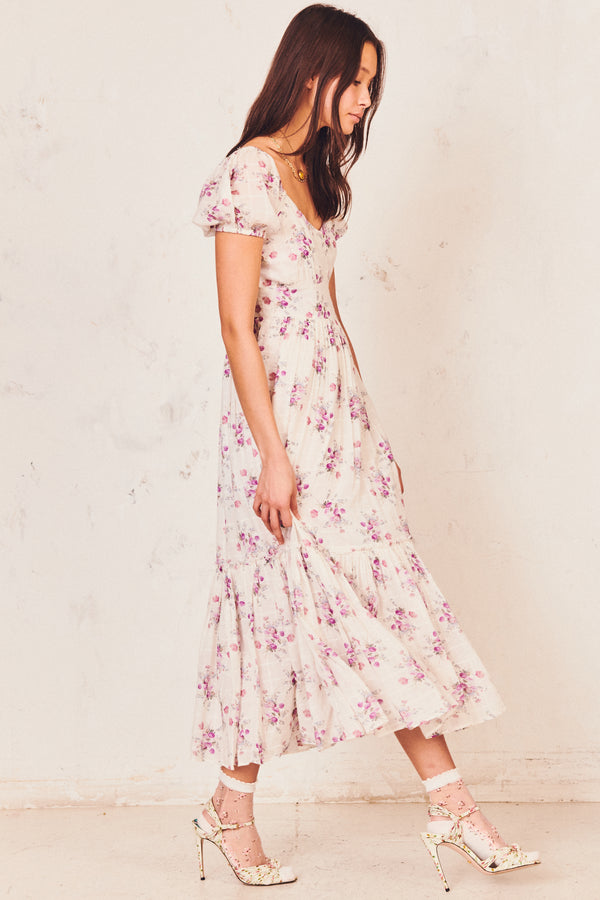 Pink and white floral maxi dress with tiered skirt and short puffed sleeve