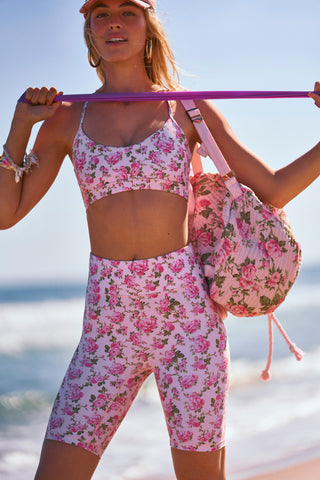 Pink floral print workout halter top with strappy criss cross back