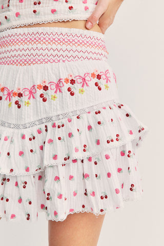 Pink and white floral embroidered skirt with smocked detailed waist