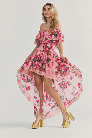 Pink and red floral high low dress with off the shoulder tiered ruffle detail and scalloped edges
