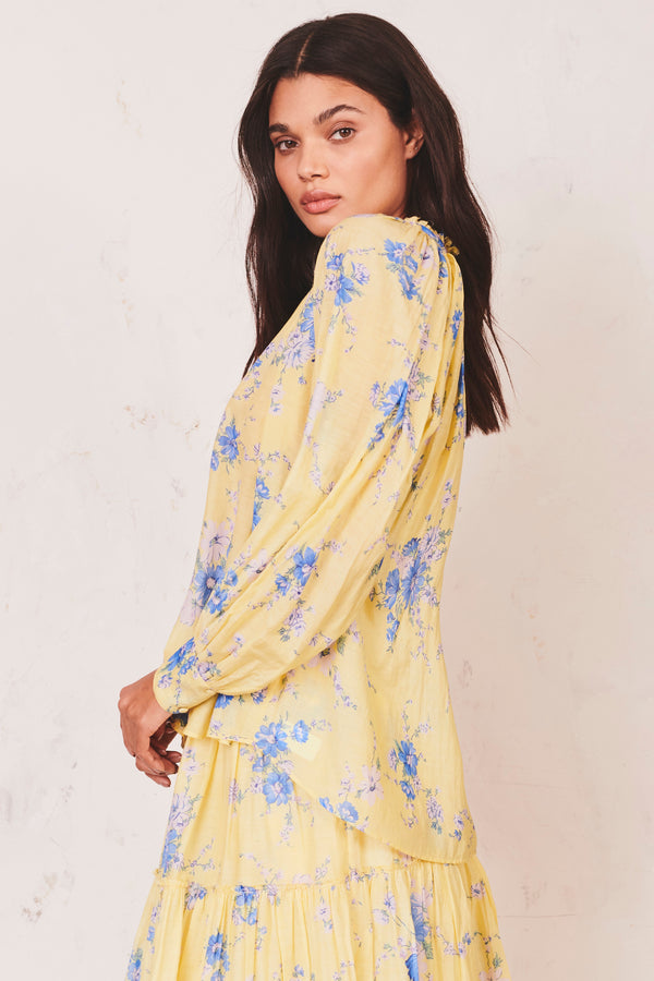 Yellow and blue floral print tie top with fitted puffed long sleeves
