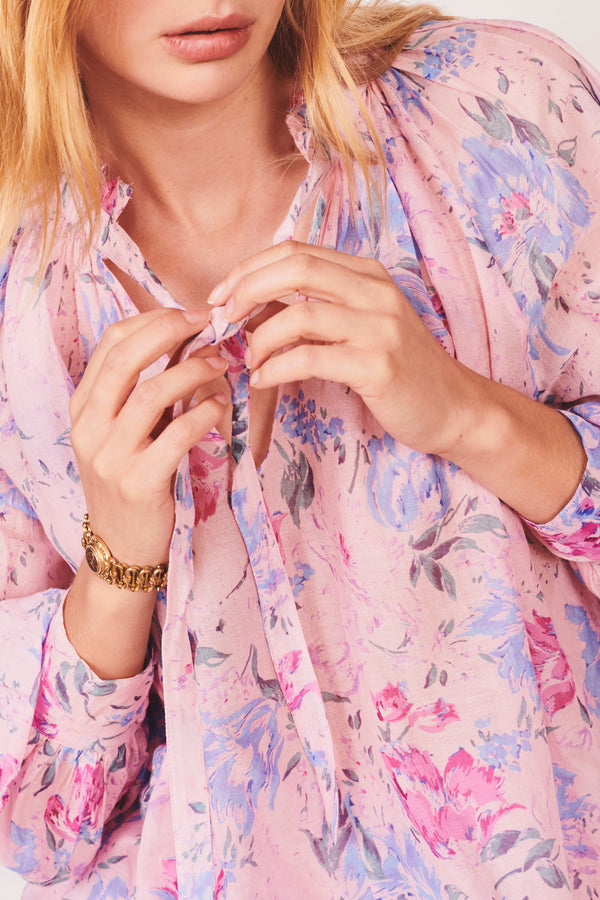 Pink and blue floral print tie top with fitted puffed long sleeves