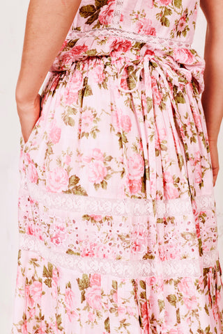 Pink floral midi skirt with white embroidery lace detail and scalloped edges on the bottom