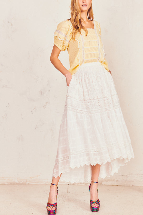 White floral midi skirt with white embroidery lace detail and scalloped edges on the bottom