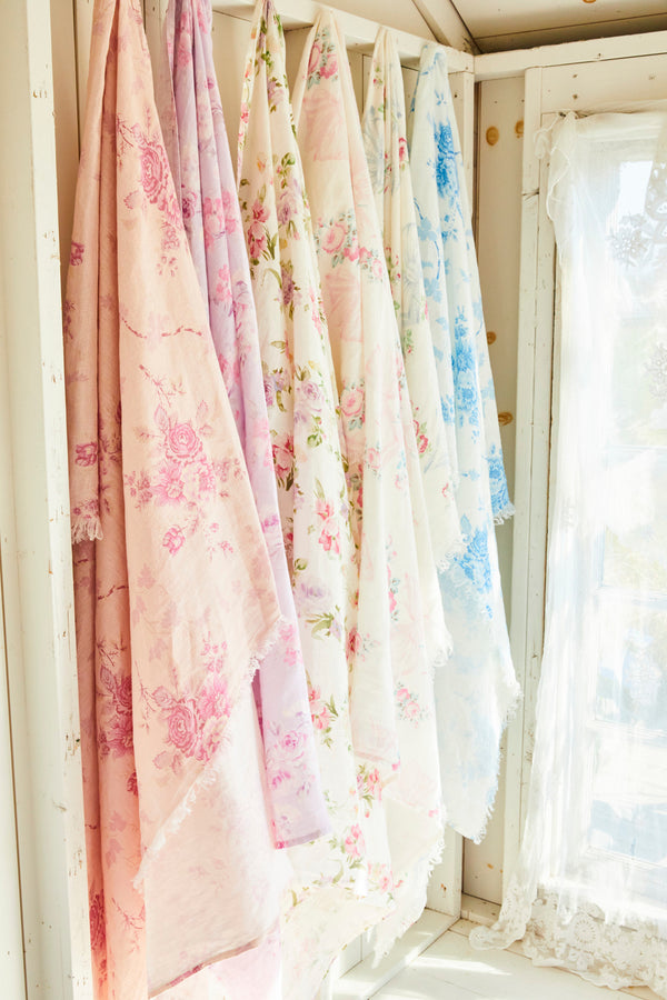 Pink floral print linen throw with bows