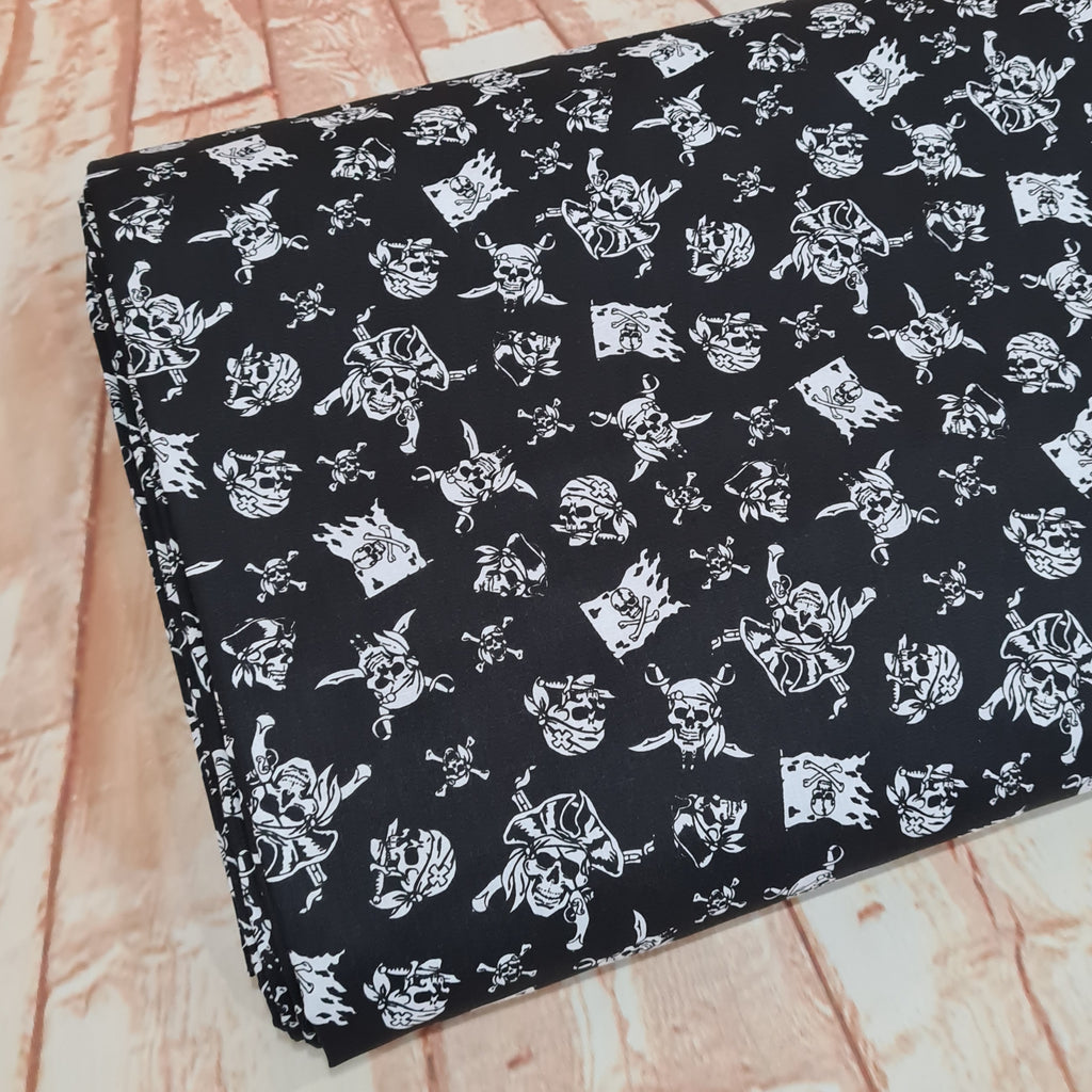 Pirates Black Cotton, priced by half metre