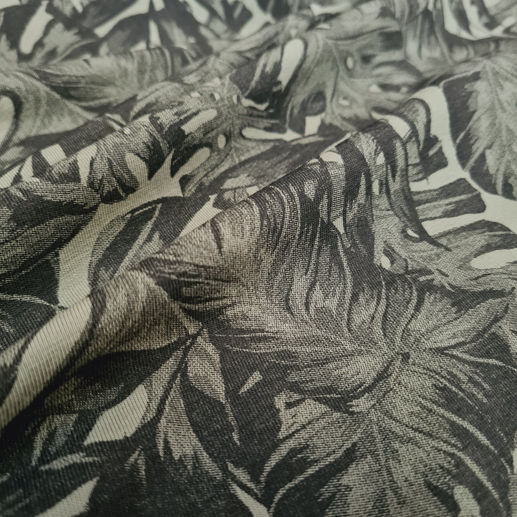 Monstera Leaves on Khaki Jersey, sold by half metre