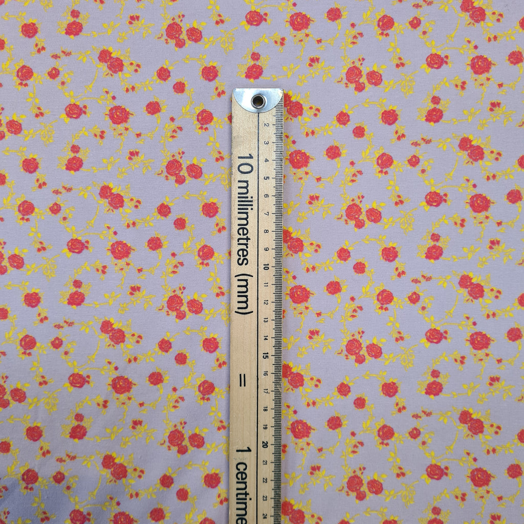 Roses on Beige Jersey, sold by half metre