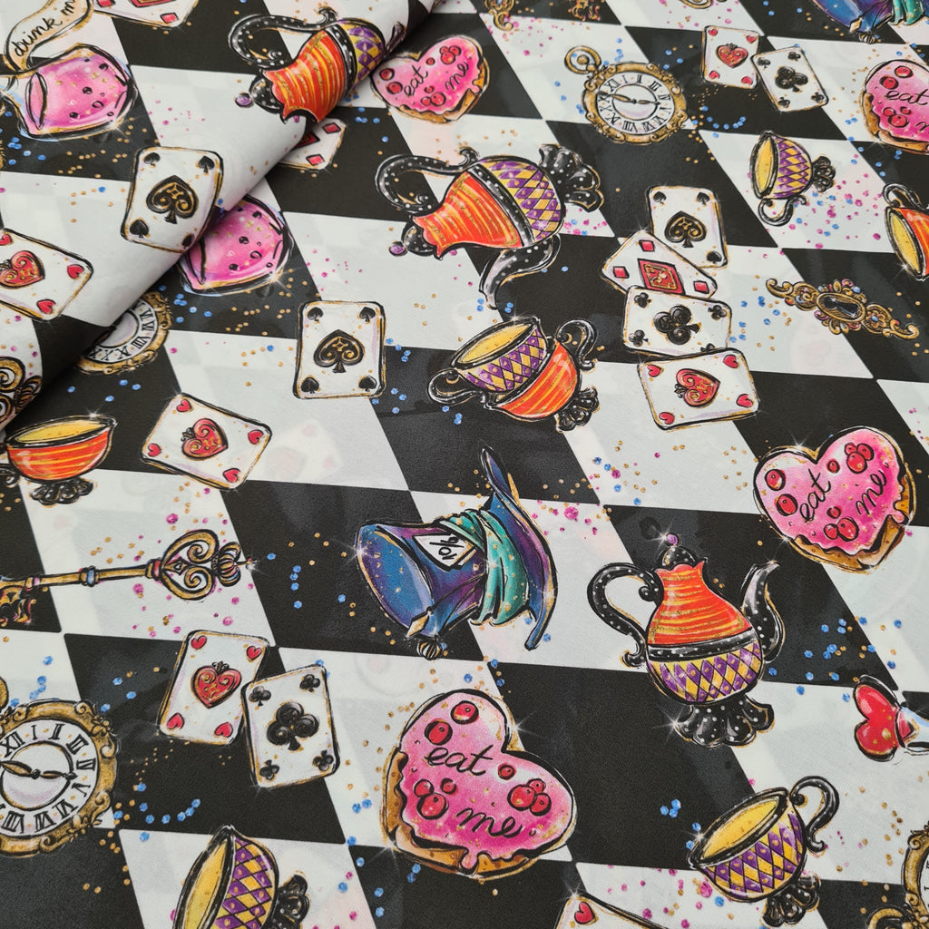 Woven Cotton Alice in Wonderland Mono, priced by half metre