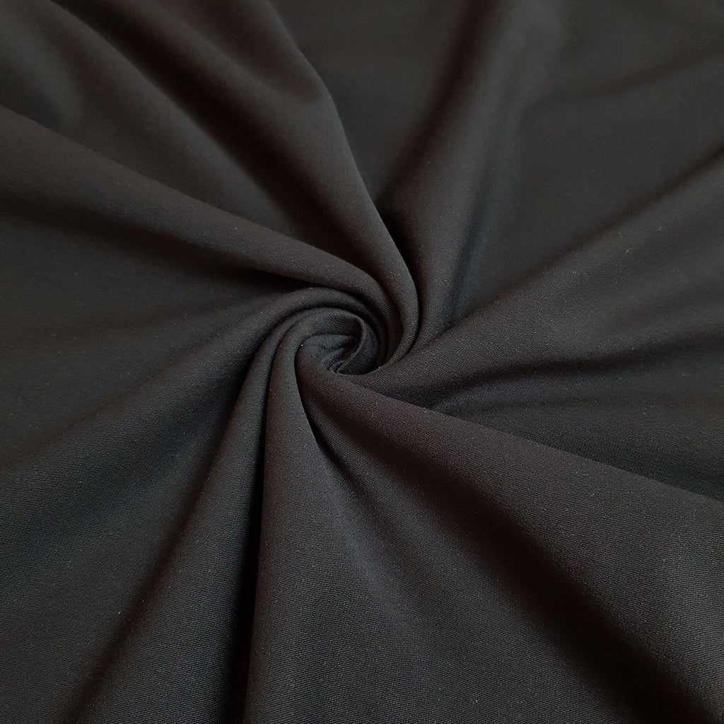 Plain Black Cotton Lycra Jersey, sold by half metre