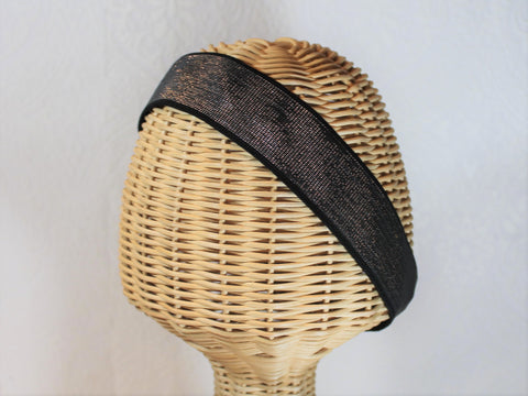 stretch headband  shimmery silver woven into a thick black band  an easy, bold accessory for your hair