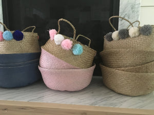 Handmade straw belly basket with pompoms