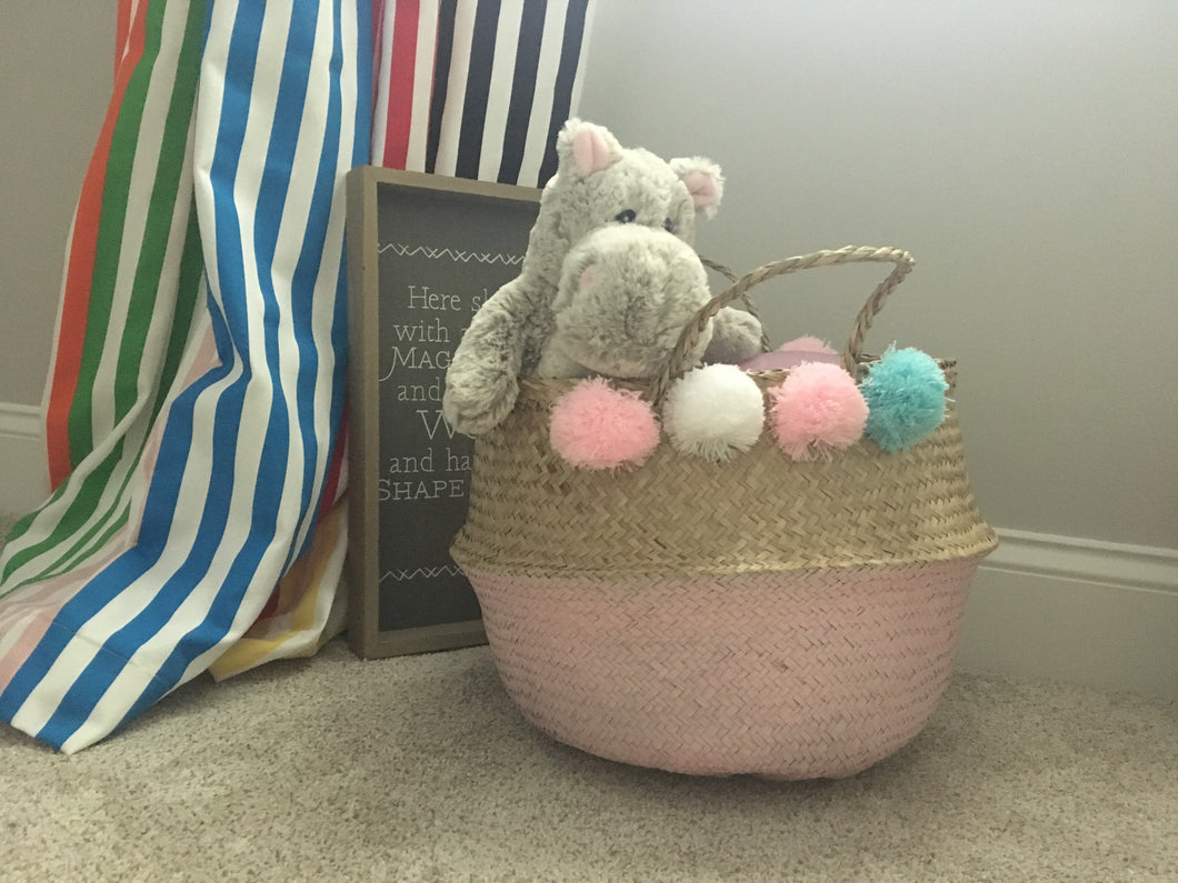 Handmade straw pink painted belly basket with 8 pompoms