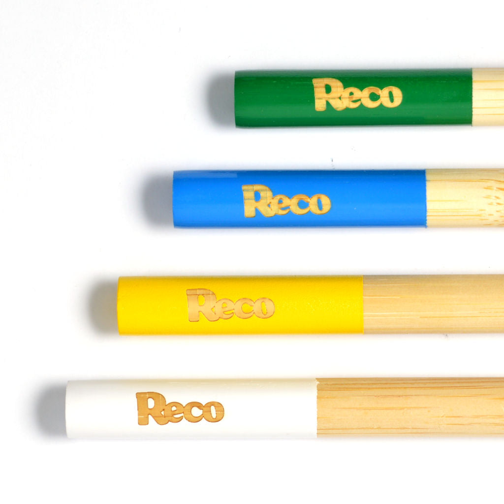 One of each colour of the Reco bamboo toothbrush stacked on top of each other
