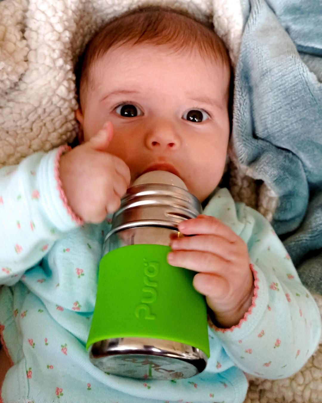 Eco-friendly baby drinking from Pura stainless steel bottle - source Pura Instagram