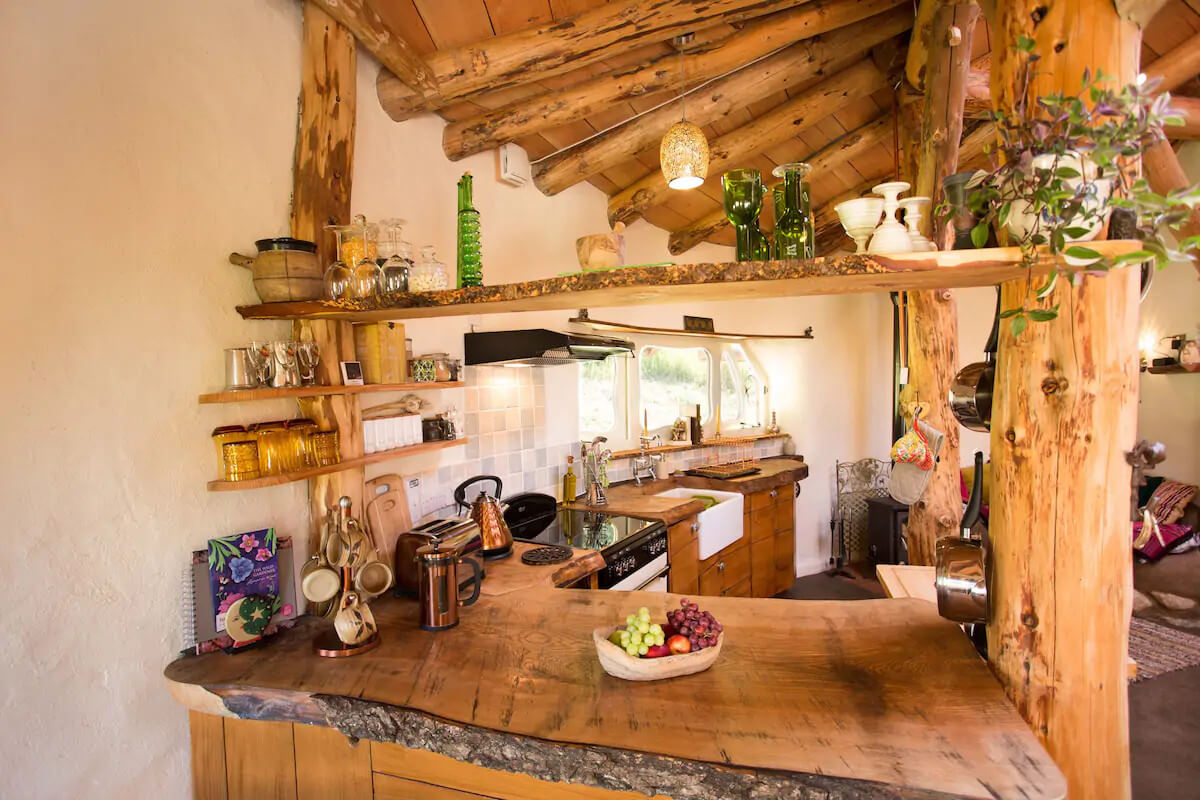 Eco retreats - Sustainable holiday accommodation - Inside Hobbit Hideaway from kitchen