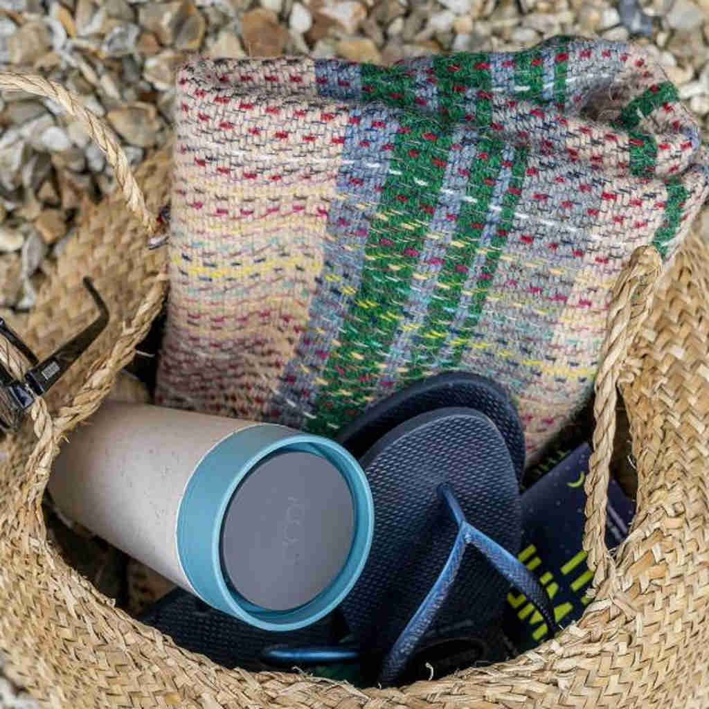 cream and teal rCup reusable coffee cup in a bag with flip flops and blanket
