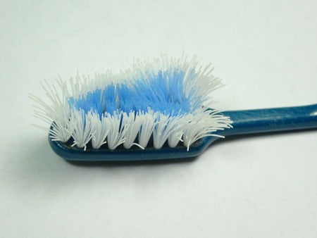 old used toothbrush with worn out bristles