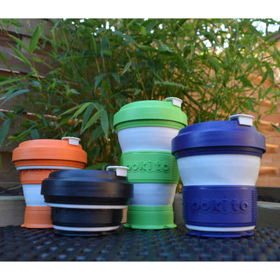 four pokito collapsible coffee cups outside infront of bamboo