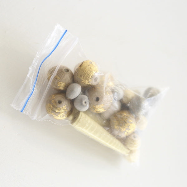 Small bag of paper beads