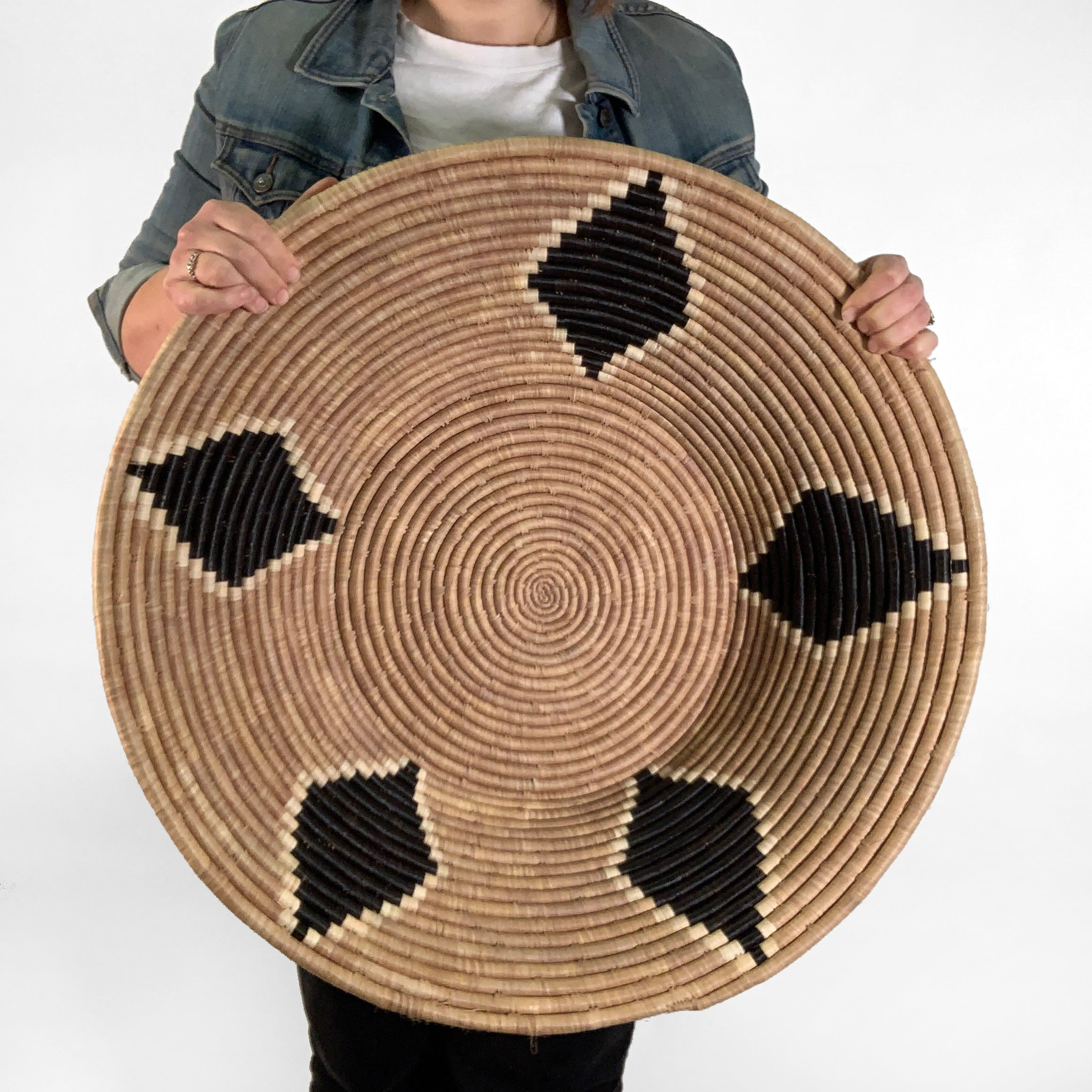 Black and tan handwoven basket