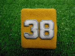 Gold  -  Wristbands with White Embroidered Numbers