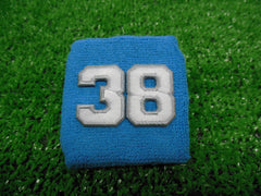 Columbia Blue  -  Wristbands with White Embroidered Numbers