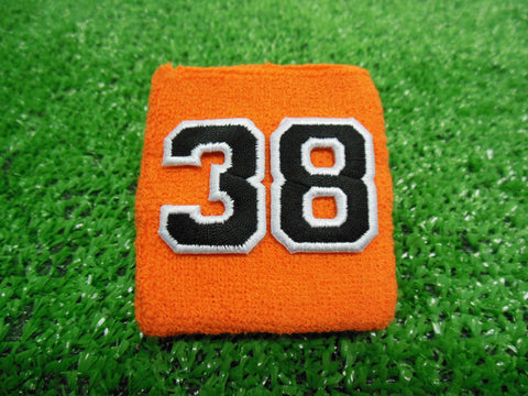 Orange  -  Wristbands with Black Embroidered Numbers