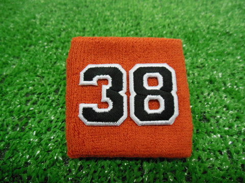 Texas Orange  -  Wristbands with Black Embroidered Numbers