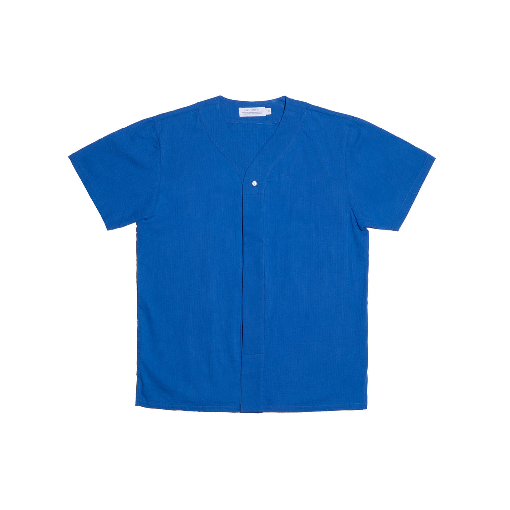 Post-Imperial Adire solid dyed azure baseball shirt. Dyed in Nigeria, Made in USA